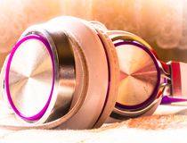Purple headphone set laying on ground. For background use or wallpaper with text layouts stock photography