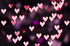 Purple heart bokeh. Valentine's Day background Stock Image