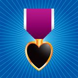 Purple heart medal on blue starburst Stock Photography