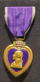 Purple Heart medal on a dark background. NO INSCRIPTION SHOWN Royalty Free Stock Image
