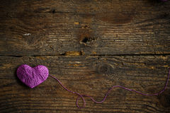 Purple Heart on on old shabby wooden background. Image of Valentines day Stock Photography