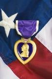 Purple Heart On USA Flag Stock Photos