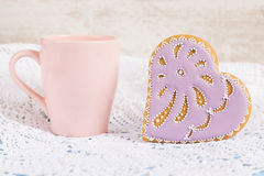 Purple heart shape cookie with pink cup Stock Photo