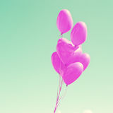 Purple Heart-shaped balloons Stock Images