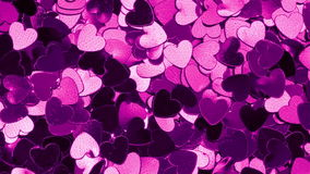 Purple heart shaped confetti changing color stock video footage