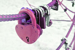 Purple heart-shaped lock on a snow background Stock Photography