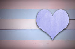 Purple heart sign on blue and pink retro wood. En panel background Stock Image