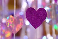 Purple heart sign paper mobile hanging from a string stock photo
