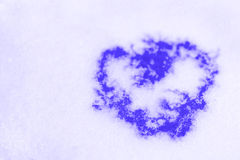 Purple heart on to snow Stock Photography