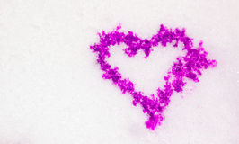 Purple heart on to snow Stock Images