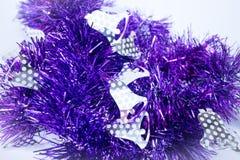 Purple holiday decoration ribbon on white background Stock Image
