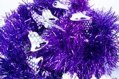 Purple holiday decoration ribbon on white background Royalty Free Stock Image