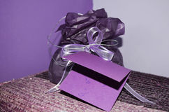 Purple  Holiday  hand made card, Christmas / Gift Birthday card and purple present. Holiday card, Christmas / Gift Birthday card and purple present  in a purple Royalty Free Stock Photo