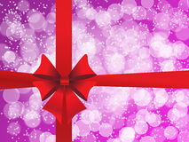 Purple holiday's background with a red bow Stock Photo