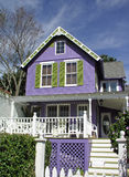 Purple house. Purple home with white fence Stock Photos