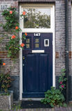 A Purple House Door in Amsterdam Royalty Free Stock Images