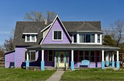 Purple House. This is a Spring picture of a two story wood house painted purple and white located in Fargo, North Dakota in Cass County.  This picture was taken Stock Photo