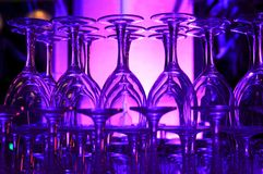 Purple hued stacked wine glasses Stock Photo