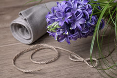 Purple hyacinth, linen cloth and cord twirl on wood Royalty Free Stock Image
