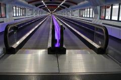 Purple illuminated travelator Royalty Free Stock Photo
