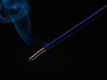 Purple incense stick. Burning with smoke rising royalty free stock photography