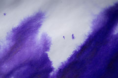 Purple ink stain on a sheet of white paper, macro Stock Photos
