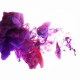 Purple Ink swirling in Water Royalty Free Stock Photography