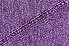 Purple jeans cloth texture with stitch. Stock Images