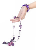 Purple jewelry and bracelet with human hand stock photography