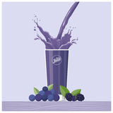 Purple juice pouring into a glass. With blackberries and blueberries, healthy drink concept Royalty Free Stock Photo