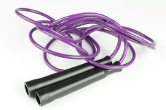Purple Jump Rope. Black plastic handles with purple jump rope on a white background Stock Image