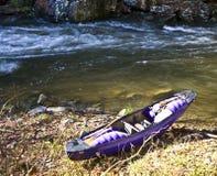 Purple Kayak on the River Bank royalty free stock image