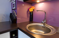 Purple kitchen detail. Modern white and purple kitchen interior Stock Photography