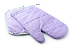 Purple kitchen glove and potholder isolated on a white Stock Photography