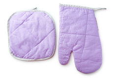 Purple kitchen glove and potholder isolated on a white Stock Images