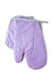 Purple kitchen glove and potholder isolated on a white Royalty Free Stock Image