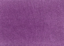 Purple knitted material texture. Stock Photo