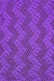 Purple knitted openwork Royalty Free Stock Photography