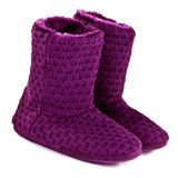 Purple knitted slipper boots Royalty Free Stock Images