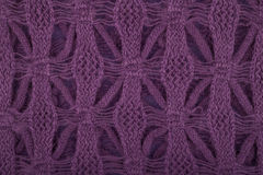 Purple knitted texture. Deep purple knitted textile background Royalty Free Stock Photo