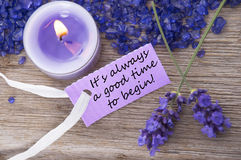 Purple Label With Life Quote Its Always A Good Time To Begin And Lavender Blossoms. Purple Label With Candle Light And Lavender Blossoms With English Life Quote royalty free stock photos