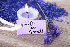Purple Label With Life Quote Life Is Good And Lavender Blossoms. Purple Label With Candle Light And Lavender Blossoms With English Life Quote Life Is Good Wooden Royalty Free Stock Image