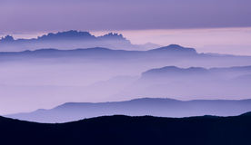 Purple landscape. Mountain skyline in the fog royalty free stock photography