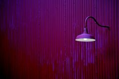Purple lantern on a purple wall Stock Photos