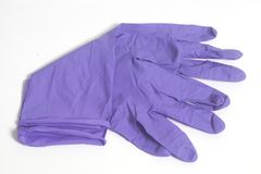 Purple latex gloves. Isolated on a white background Royalty Free Stock Photos