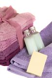 Purple and lavander towels with soap and shampoo Royalty Free Stock Photography