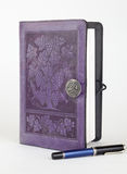 Purple leather bound writing journal and pen Stock Photography