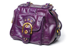 Purple leather handbag. A purple patent leather hand bag Royalty Free Stock Photos