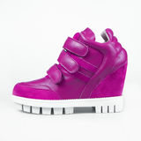 Purple leather platform sneaker Royalty Free Stock Photo