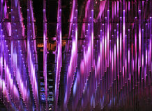 Purple led lights. Purple acrylic led lighting rods suspended from a mirrored ceiling at a high end nightclub. LED technology is the future of lighting. LEDs royalty free stock image